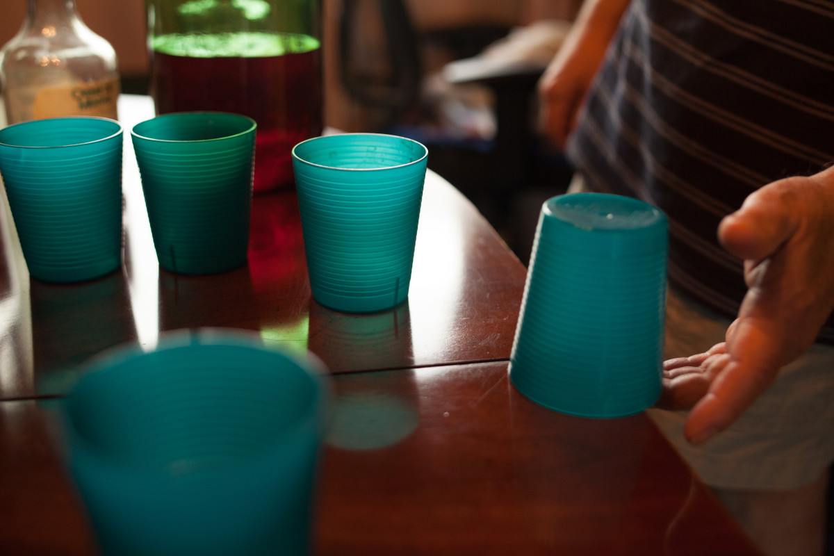 When finished with a beer players place cups upside down on the table and try to flick the cups by their overhanging rims to turn the cups right side up.