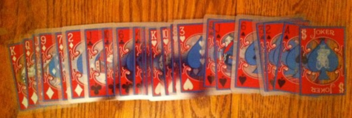 A clear, plastic set of playing cards laid out.
