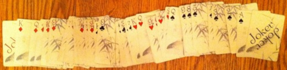 An artistic set of playing cards laid out.