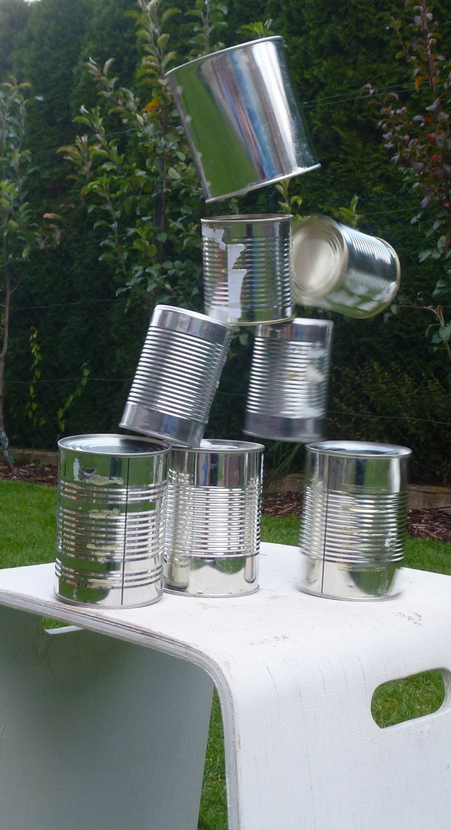 knock the cans over