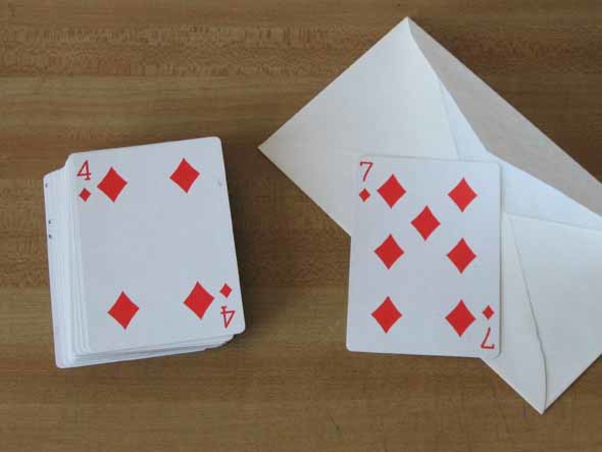 The selected card is drawn from an envelope in this trick.