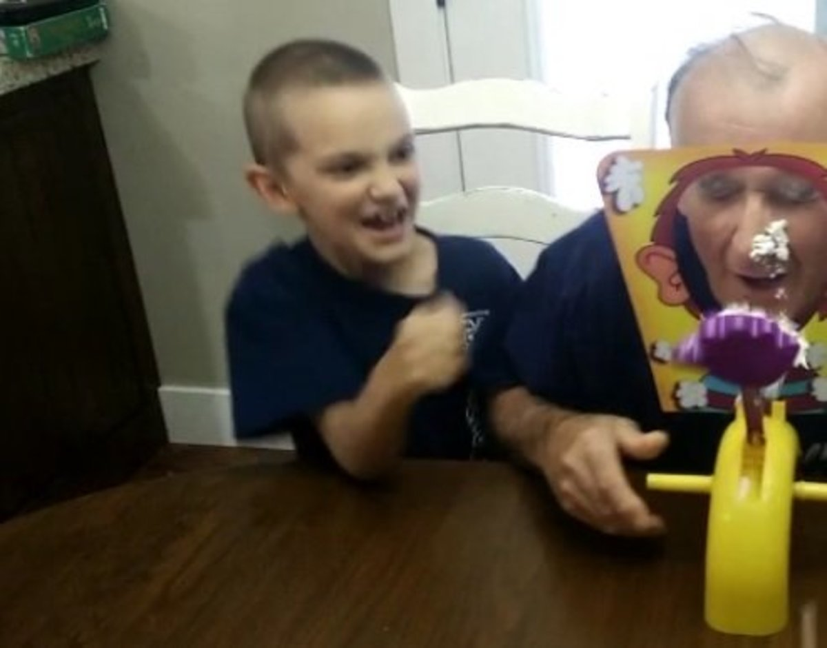 This isn't the best picture in the world but here's a look at my Dad getting hit with the whipped cream while my son laughs hysterically. Pie Face is always good for a laugh.