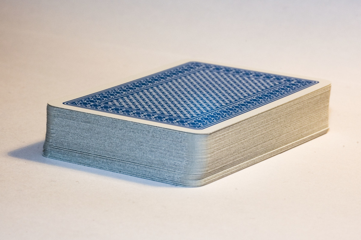 Players draw one card from a stack of cards in the center if they don't have a card to play on their turn.  If they can play the card they picked up, they may put it down.  Otherwise they must add it to their hand.