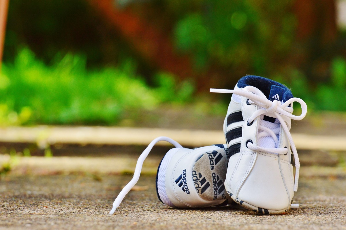 Tiny baby shoes create an emotional response.