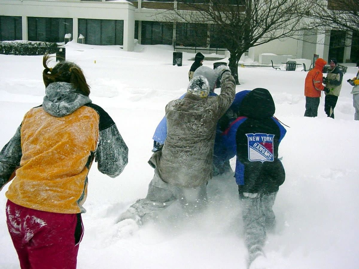 Students in New Jersey enjoy a snowball fight.