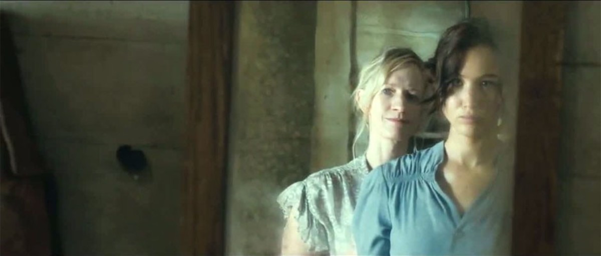 Mrs. Everdeen checks Katniss out in the mirror before the 74th Reaping.