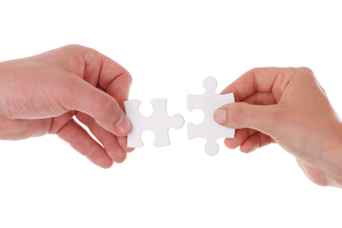 Solving a jigsaw puzzle with someone else can lead to cooperation.