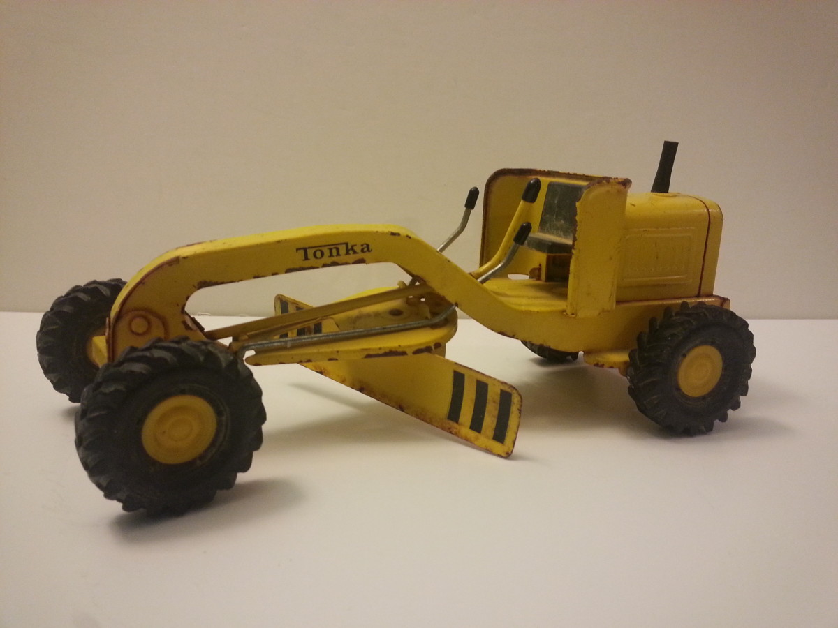 1964 Tonka mini-grader. Tonka also released 'mini' toys in the early 2000s, but those are truly minis—around 3–4 inches long. The 1964 version is almost a foot long.