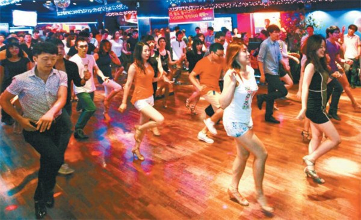 Salsa group class at a nightclub