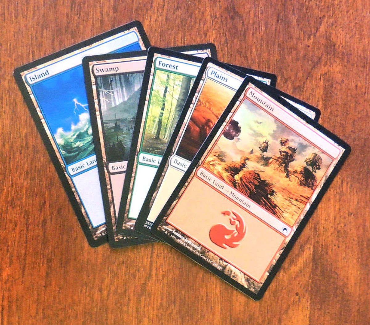 Land examples from the different card color types.