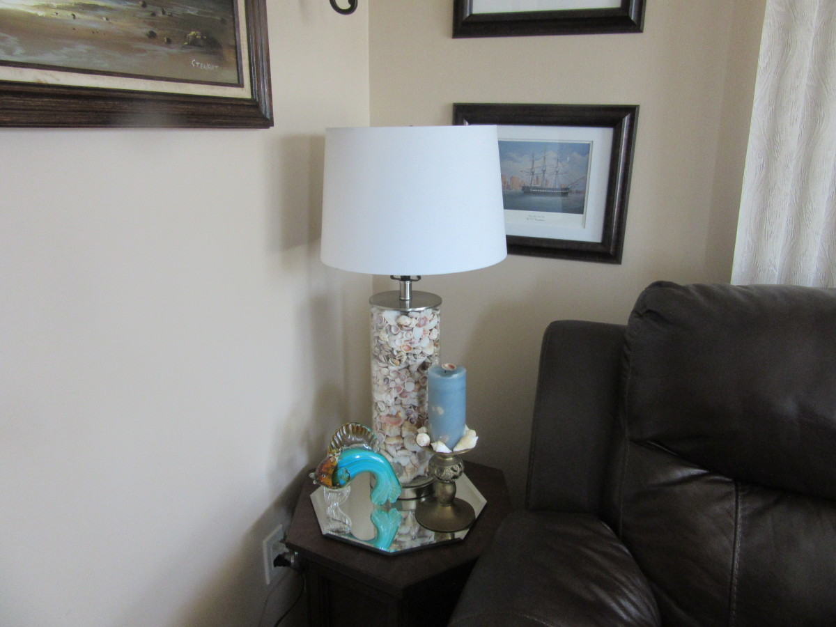 I filled this lamp with shells for the nautical theme in my living room