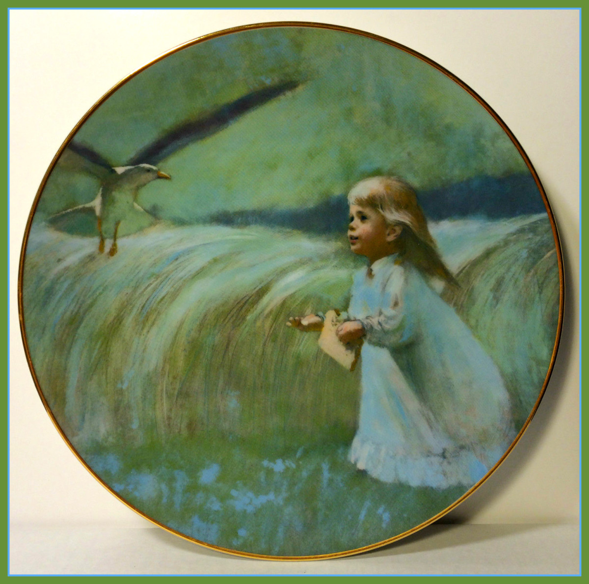 "Precious Moments collection ""A Friend in the Sky"" 1979 plate by Thornton Utz for Viletta.  A girl with a piece of bread in one hand and a part of that bread in the other, offering it to the bird flying overhead as she looks at it in awe."