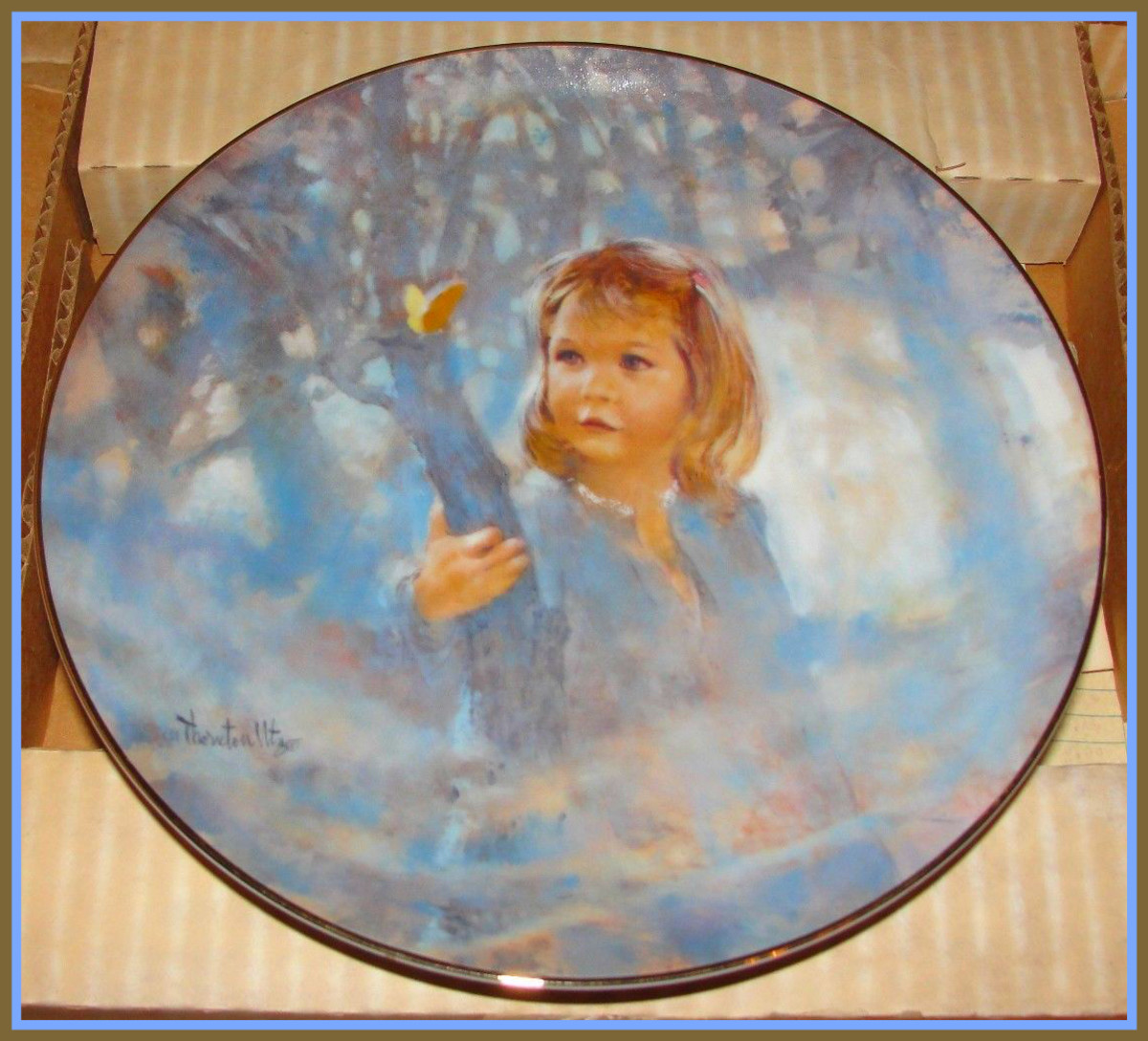 """Butterfly Magic"" was the premier plate in the annual ""Portraits of Childhood"" plate collection by Thornton Utz."