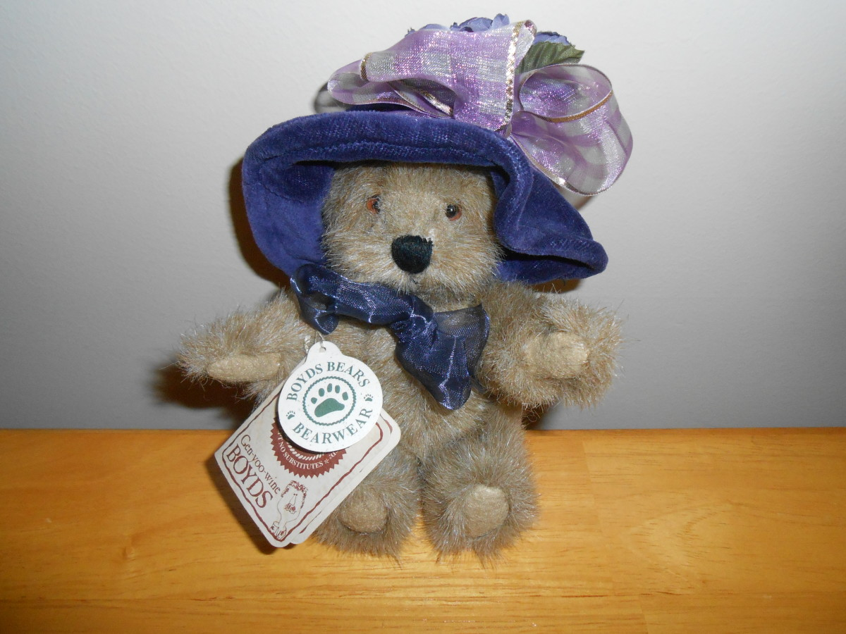 Here's one of the sweetest Boyds bears I have found. You can see she has 2 tags intact which  increases her collectible value.