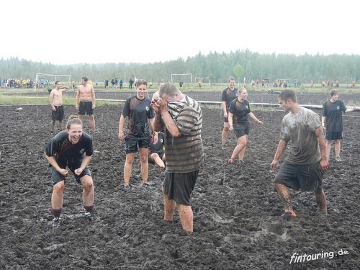 Swamp soccer being played.