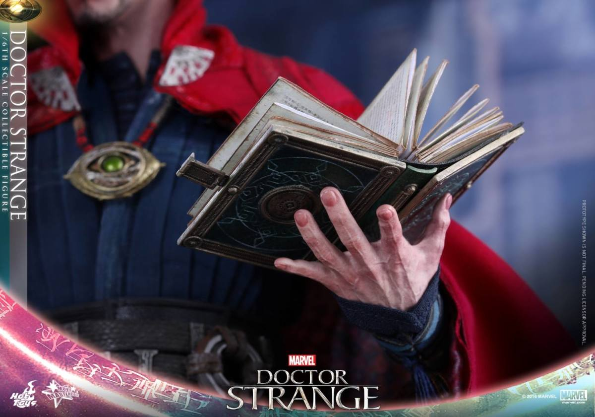 Dr Strange holding the book of Cagliostoro in the toy tie in for the Film