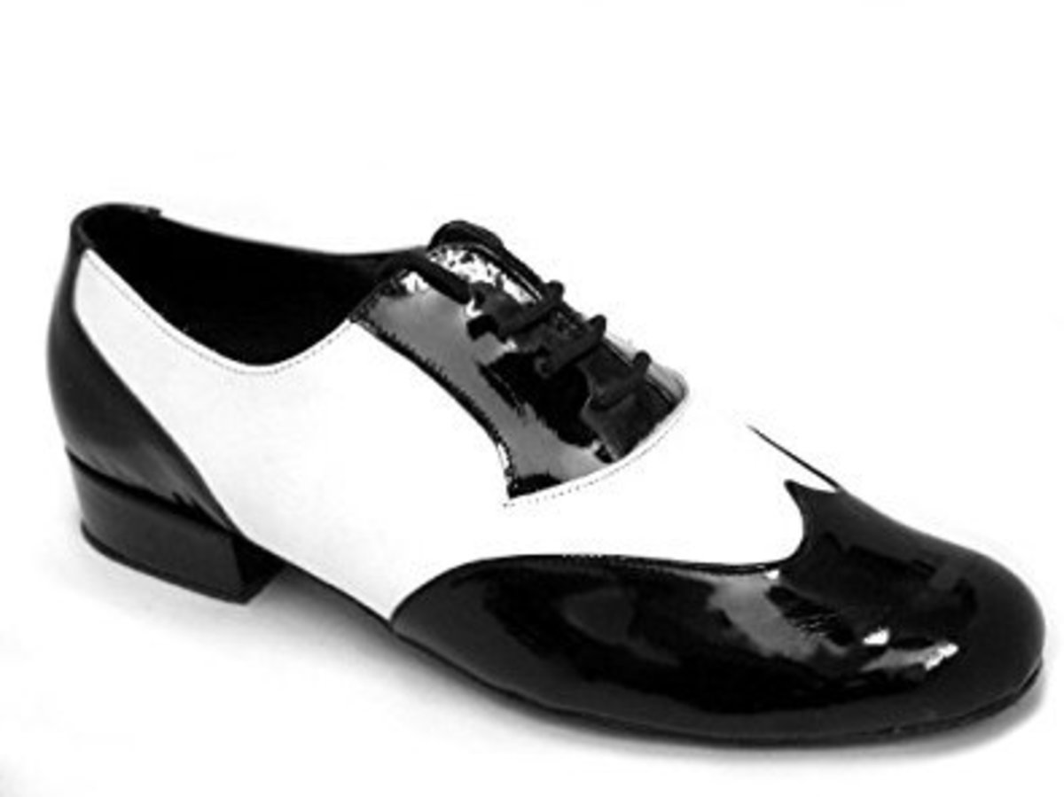 Black and white specator shoes with a low flat heel and suede bottoms are a popular choice of dance shoe for men.