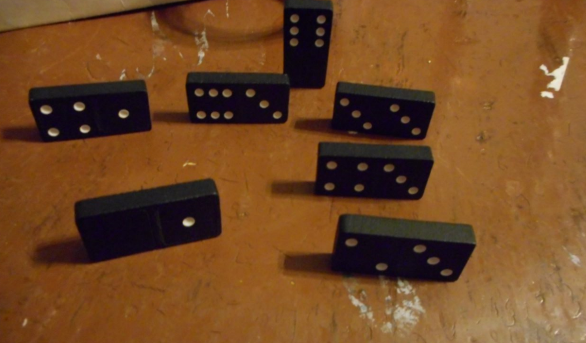 I don't have a Domino that I can play, so I place one Domino on end, signifying that I'm Up and my line is open.