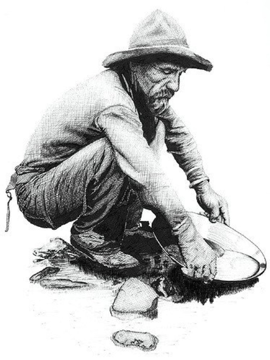 An old time prospector in a typical panning position