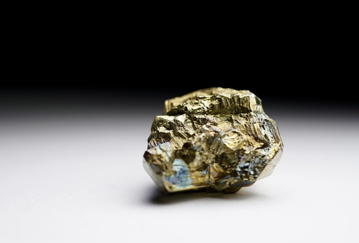 The pyrite has a more angular crystalline structure, and while gold colored, it is not as bright gold as the real thing