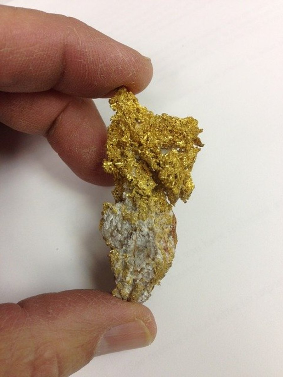 The gold nugget is a much brighter gold color, and its structure is different