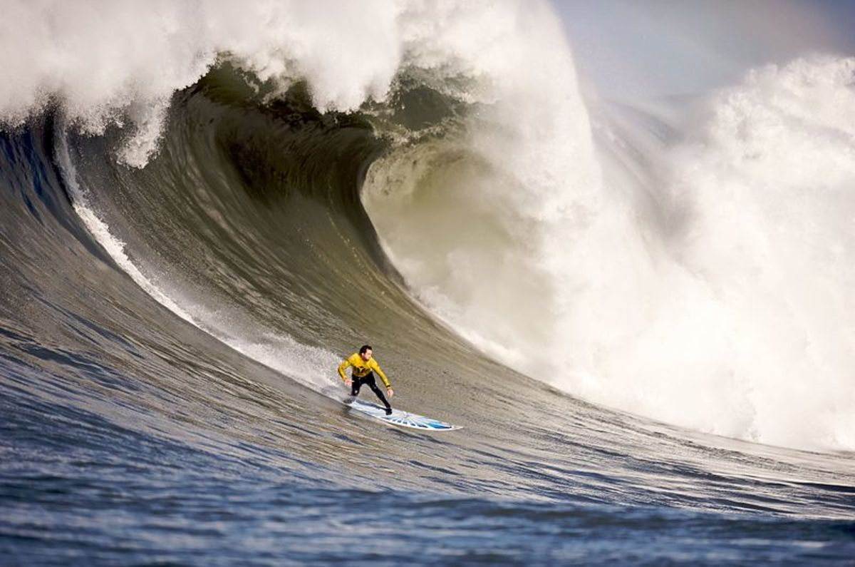 An image like this can help you imagine the adrenaline rush of surfing.