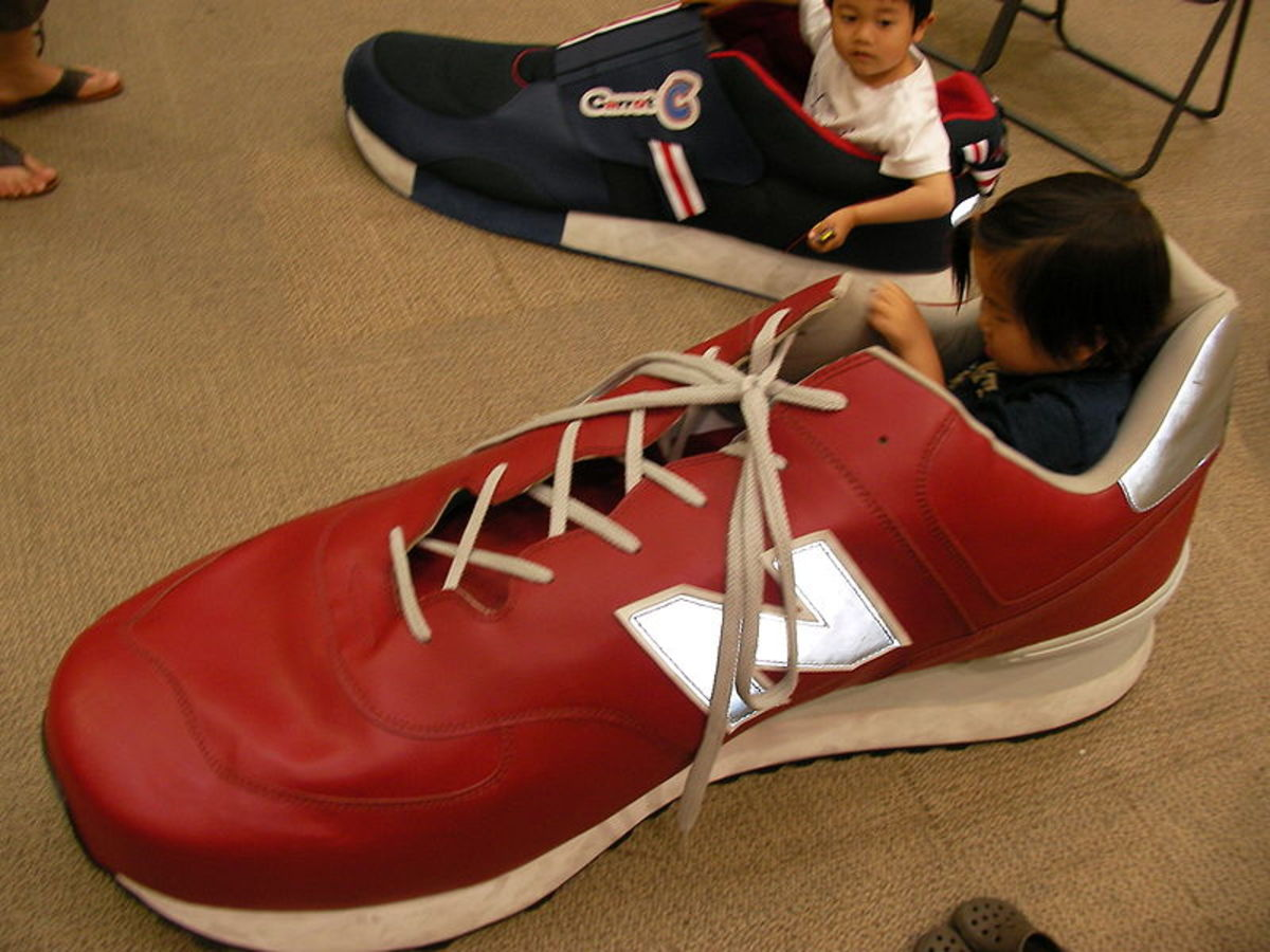 Children play in giant shoes in Japan. This picture plays with scale.