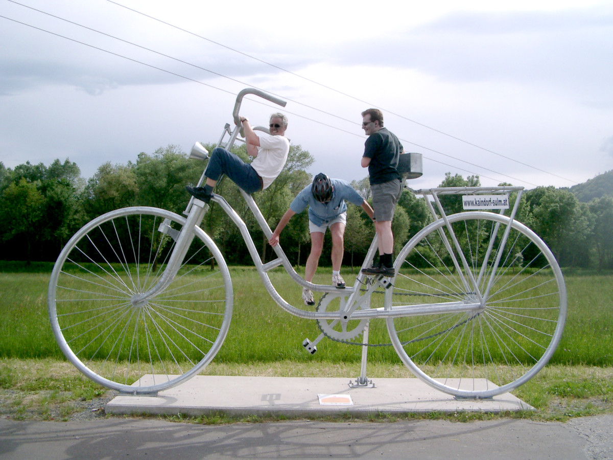 It takes three to ride a giant's bike.