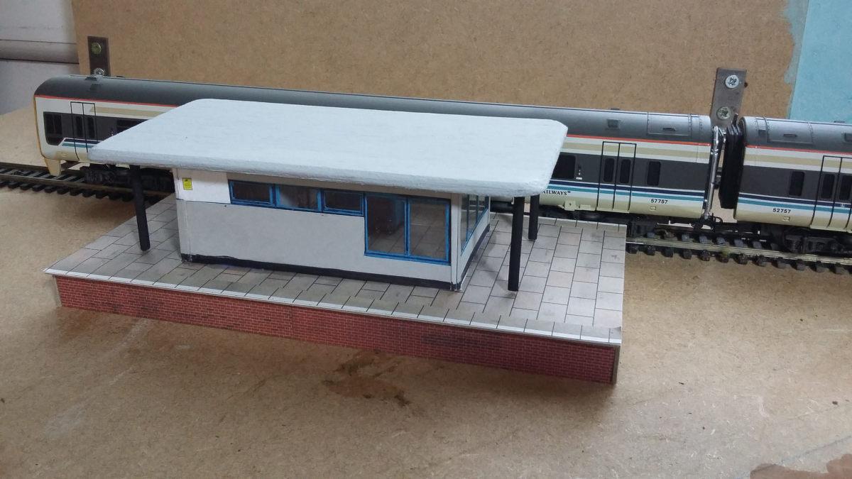 The train standing at platform three.