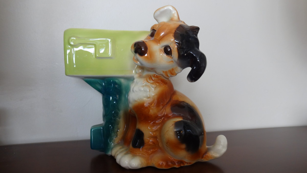 One of my earliest memories is of this Royal Copley puppy/mailbox planter. It sat on my mother's dresser, and now it resides on mine.
