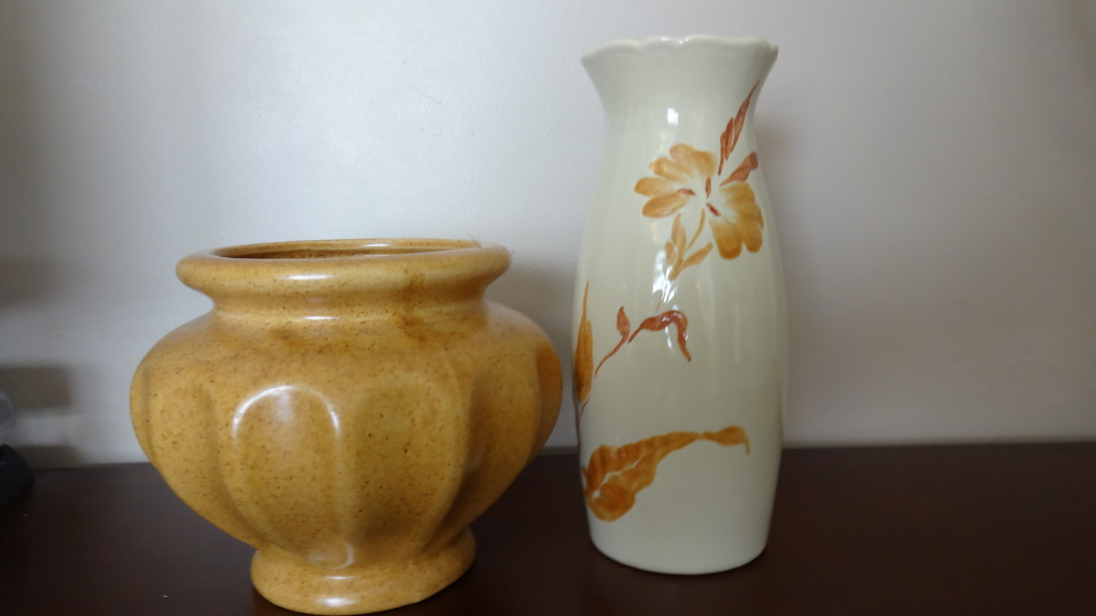 This picture shows a Haeger floral planter and a Royal Haeger small vase.