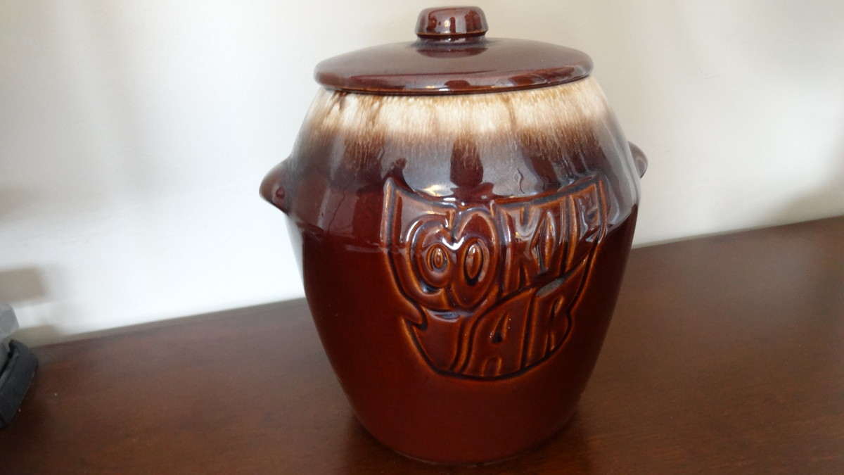 This is a McCoy brown drip glaze cookie jar from the 1970s.