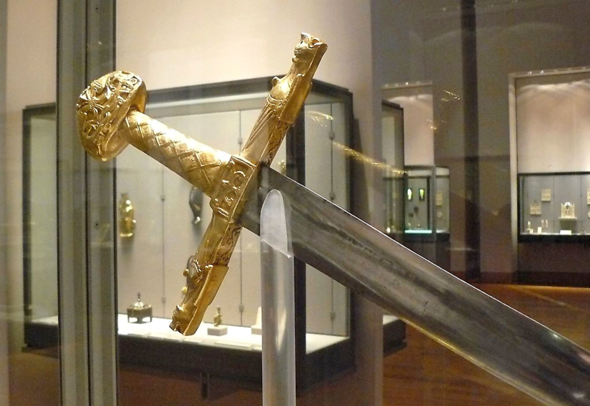 Is the Joyeuse displayed in the Louvre the actual sword used by Charlemagne? Experts continue to debate.