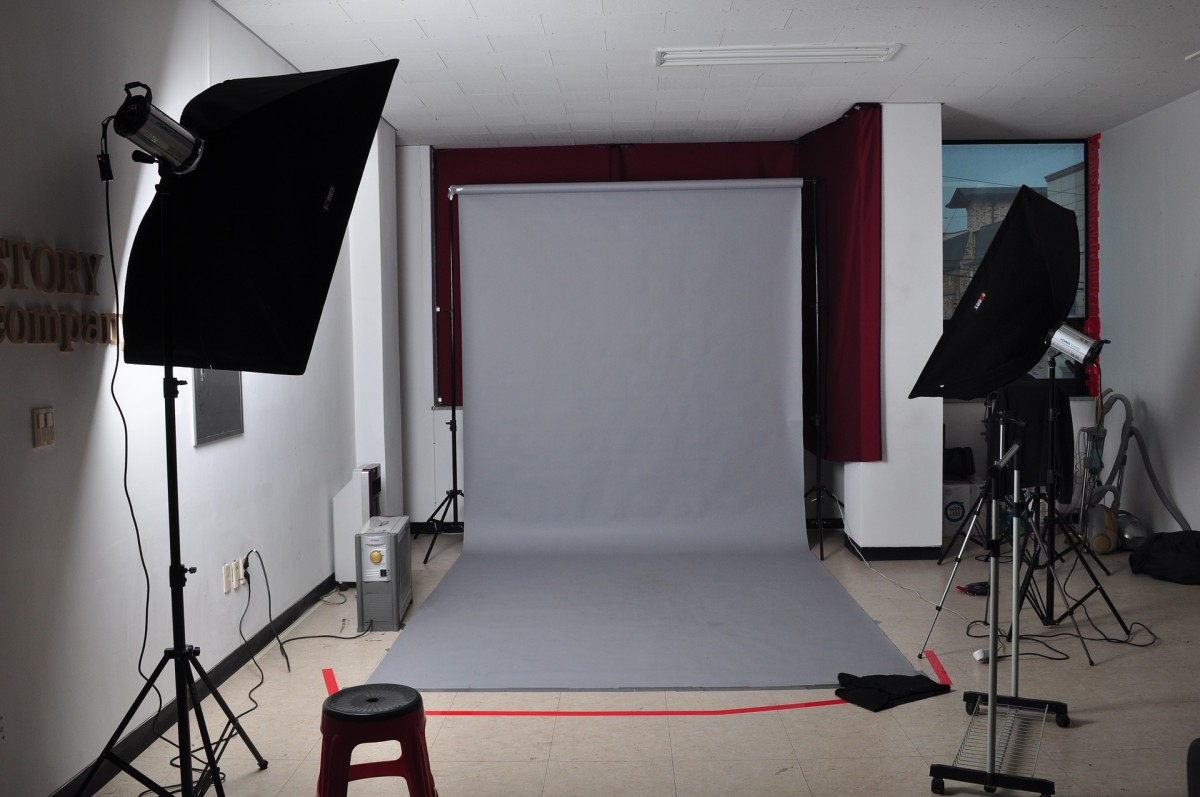Use one wall for the dual function of practicing in front of a stage and for photographing or video taping promotional material.