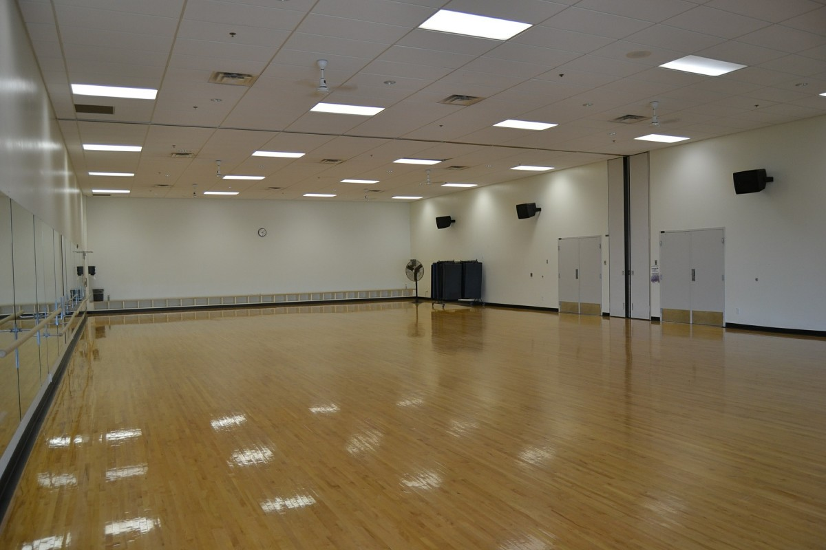 The first studio can be a simple empty room as floor space and mirrors are the two most essential tools for the instructor and students..