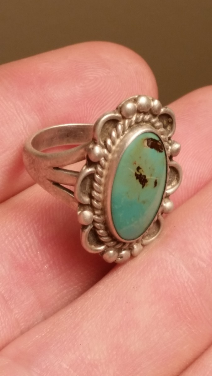 A silver ring I found in a curb strip in front of an old house.