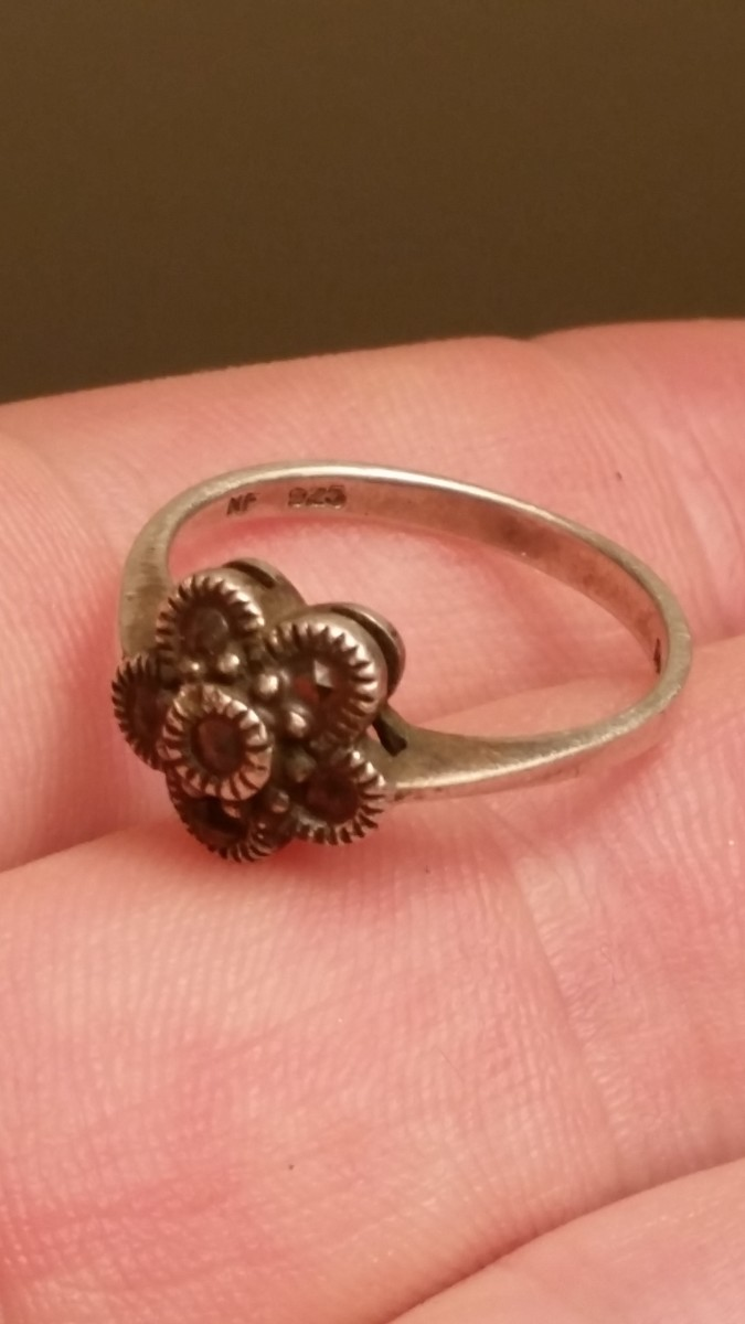 A marcasite ring found while metal detecting a curb strip.