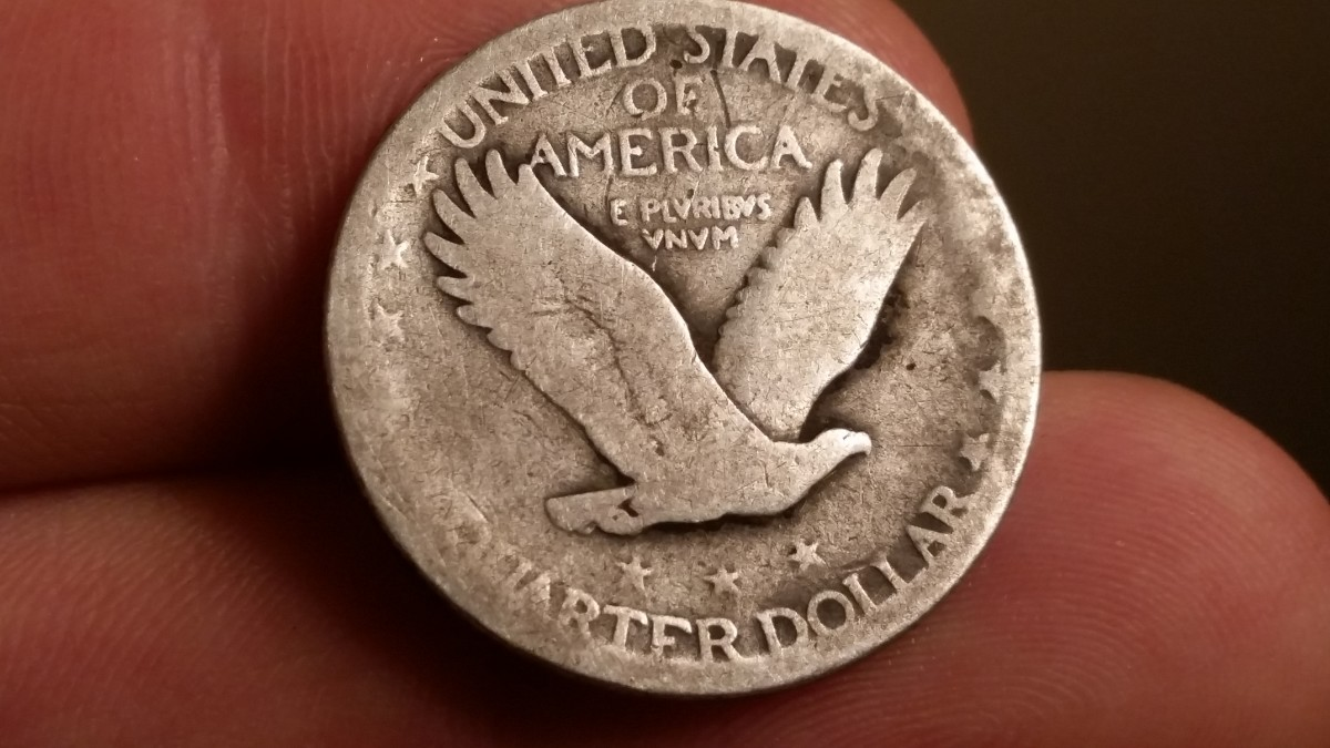 A silver Standing Liberty quarter I found in my yard metal detecting.
