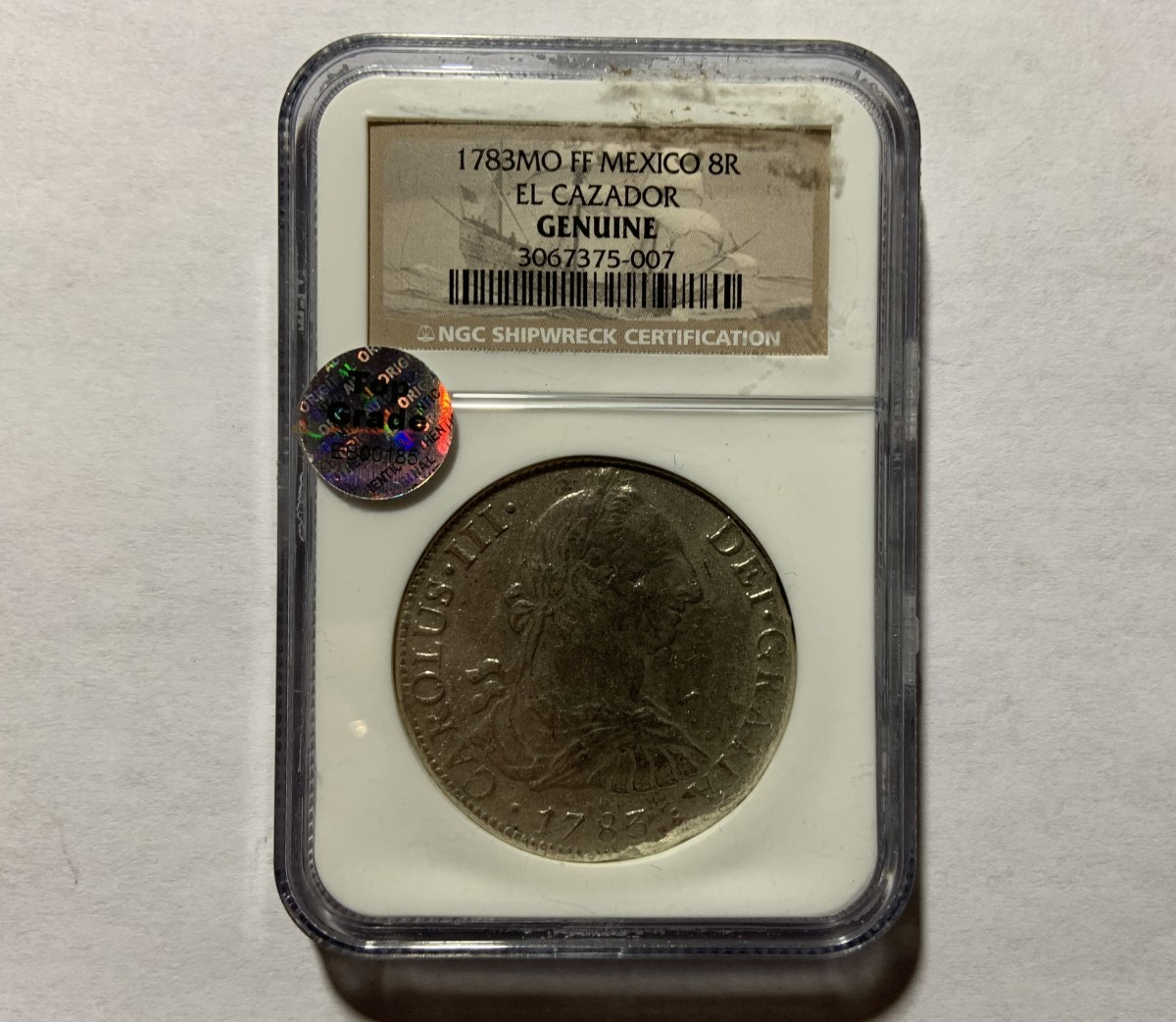 """A professionally graded and authenticated coin. Not all holders say the word """"Genuine""""; it is implied by being in a professionally graded coin holder."""