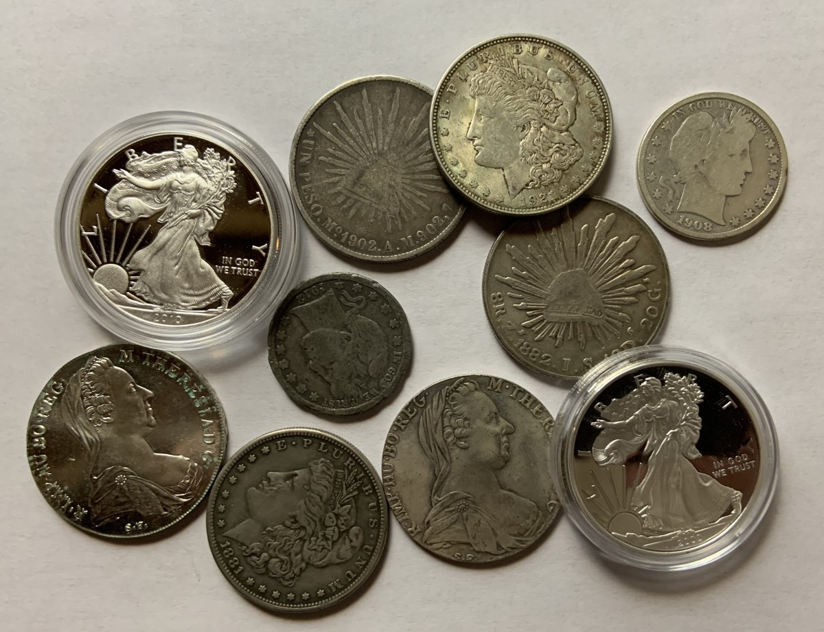 Half the coins in this picture are real and half are counterfeit—can you tell the difference? If not, read on.