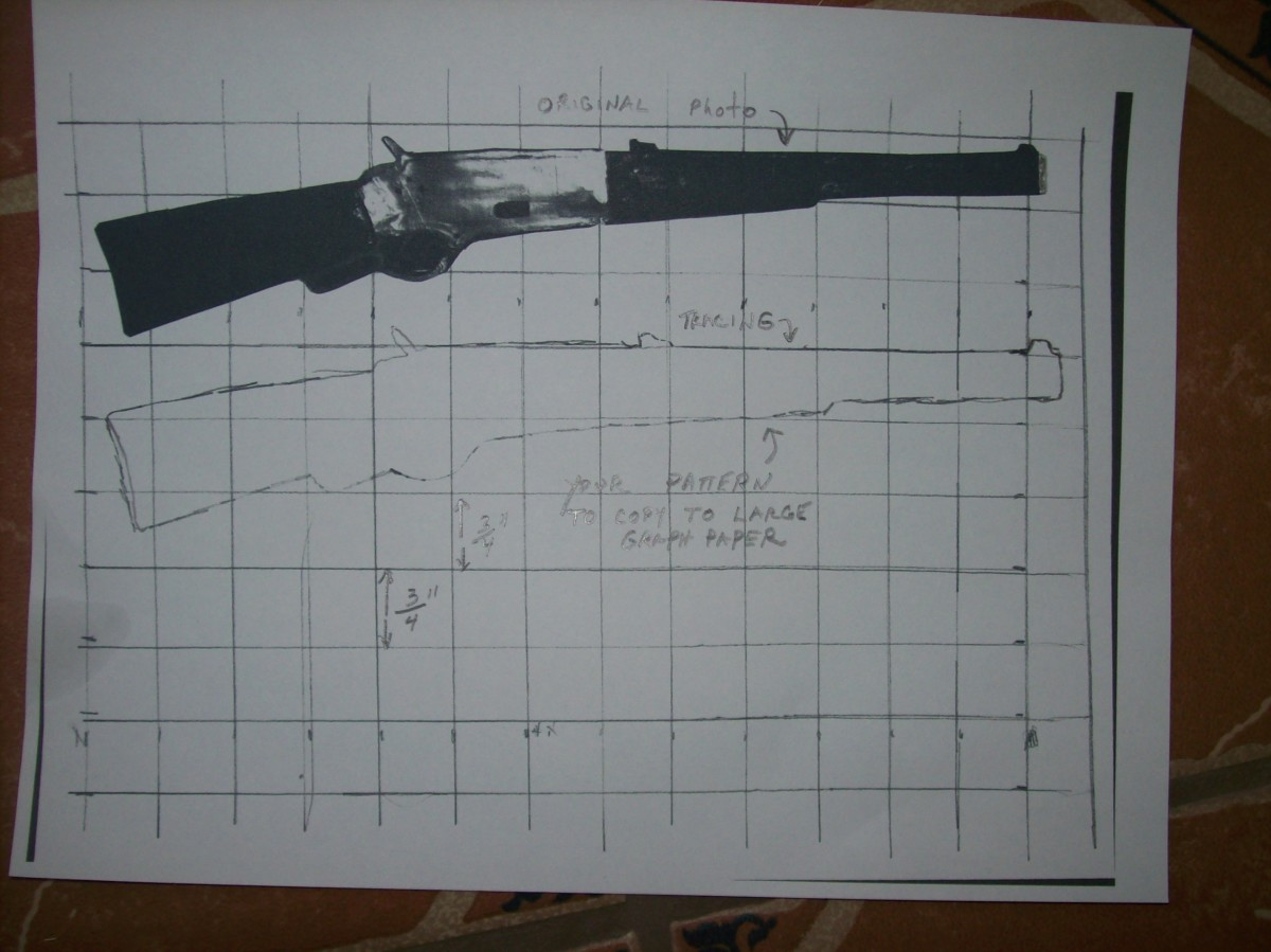 "The top image is a cutout about 10"" long of a Winchester. The bottom sketch of the top photo is what you will use to transfer to a larger grid."