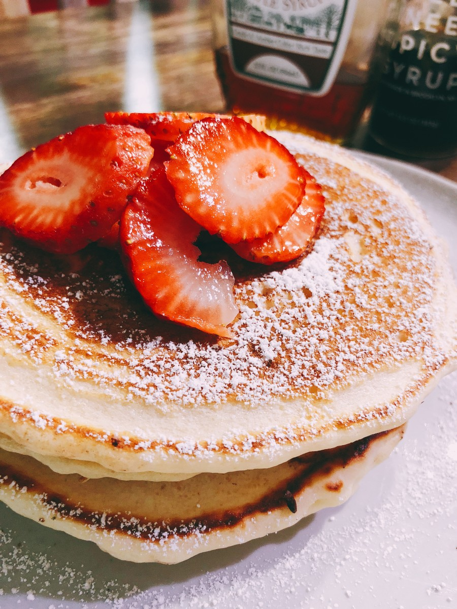 Delicious stack of pancakes with fresh strawberries.