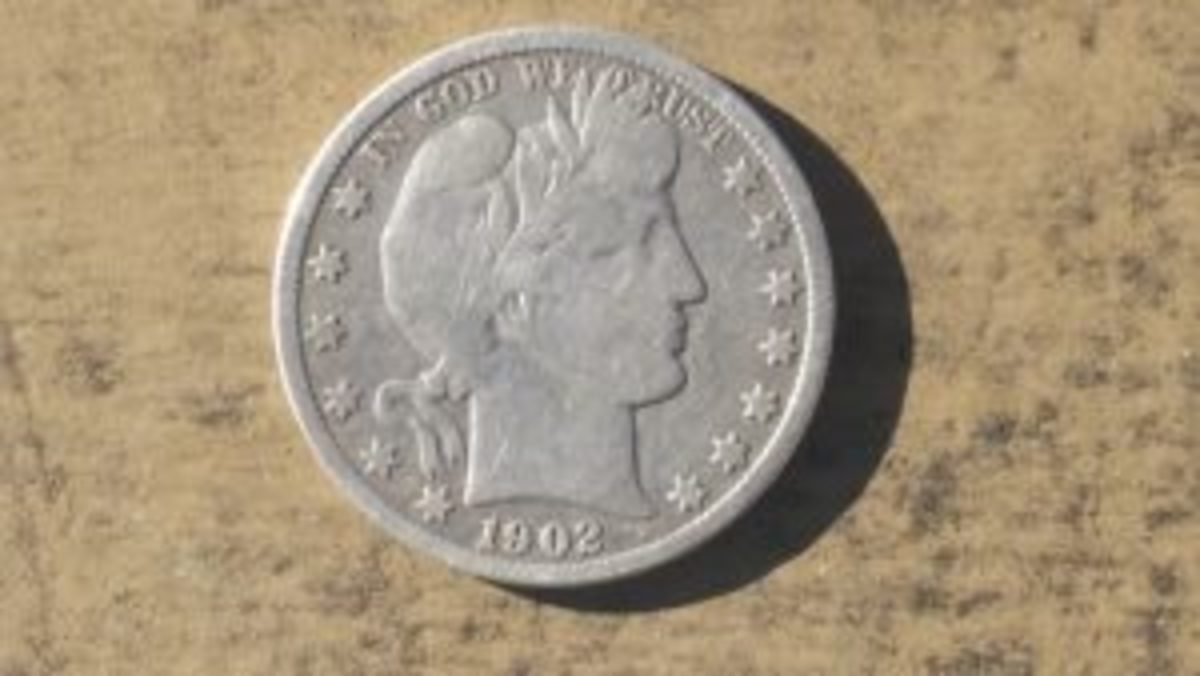 A 1902 silver Barber dime I found metal detecting a private property permission.