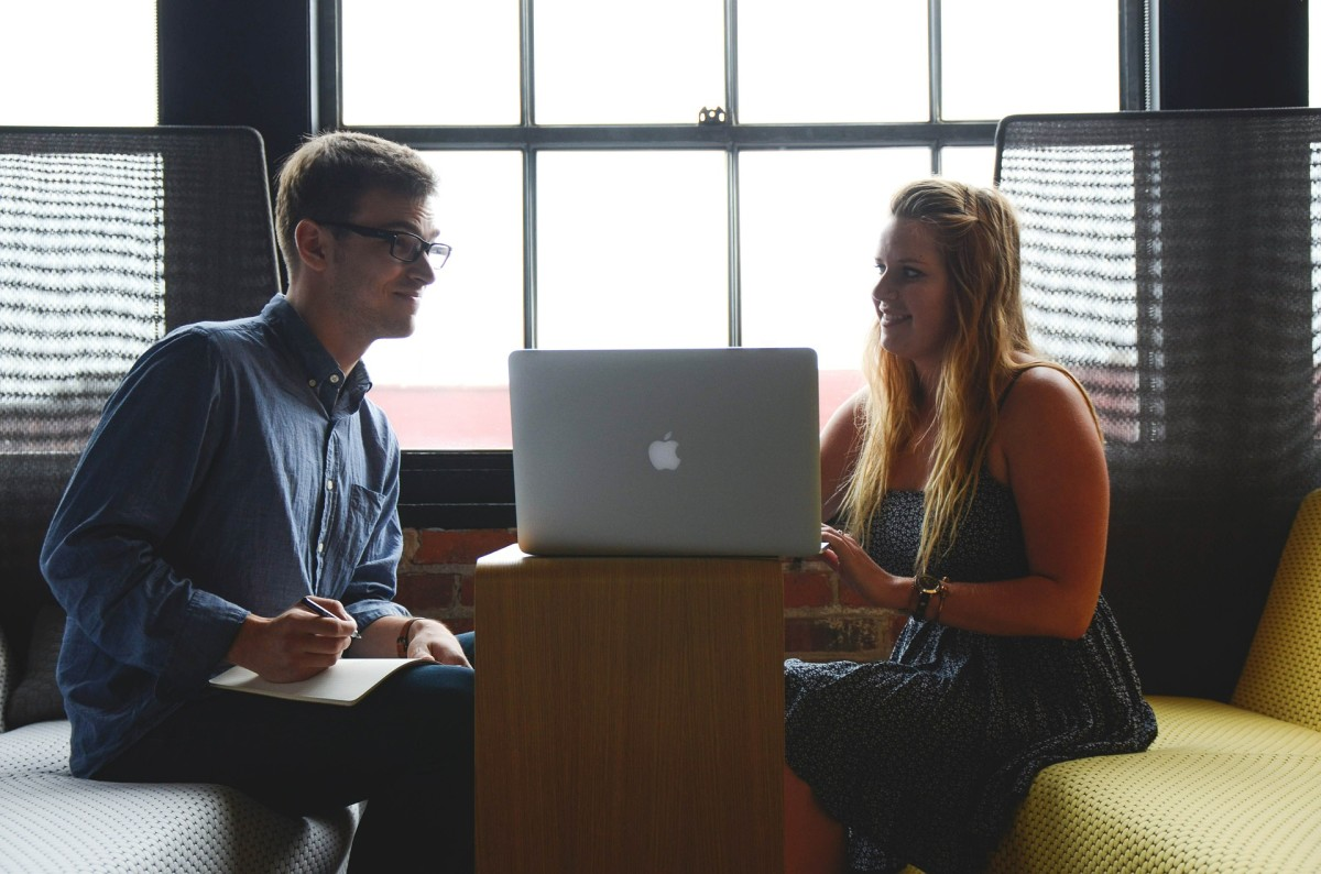 How to Tell If a Guy at Work Likes You: 5 Signs to Watch for