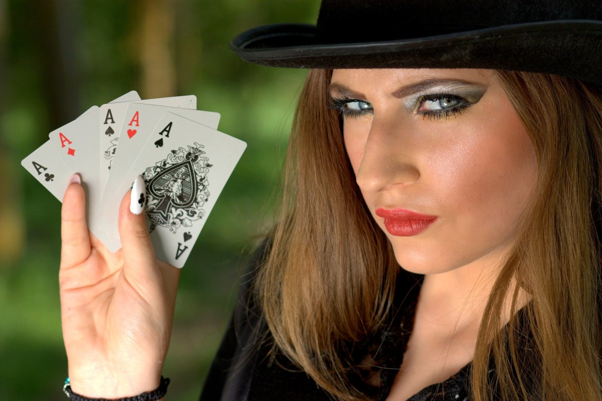 Playing card tarot: a lady with all the Aces. It's a 'yes' from me!