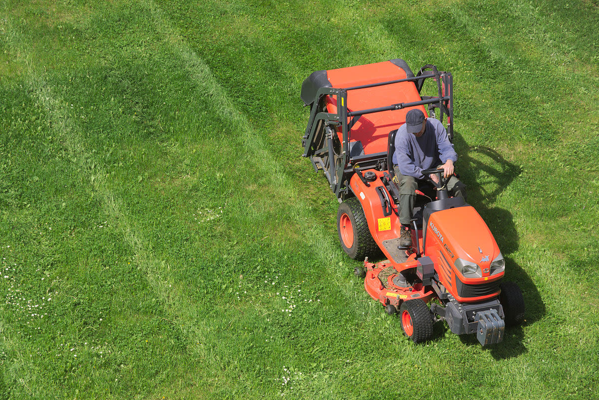 A commercial lawn tractor, not mower. You must know the difference so you can understand the narrative below.