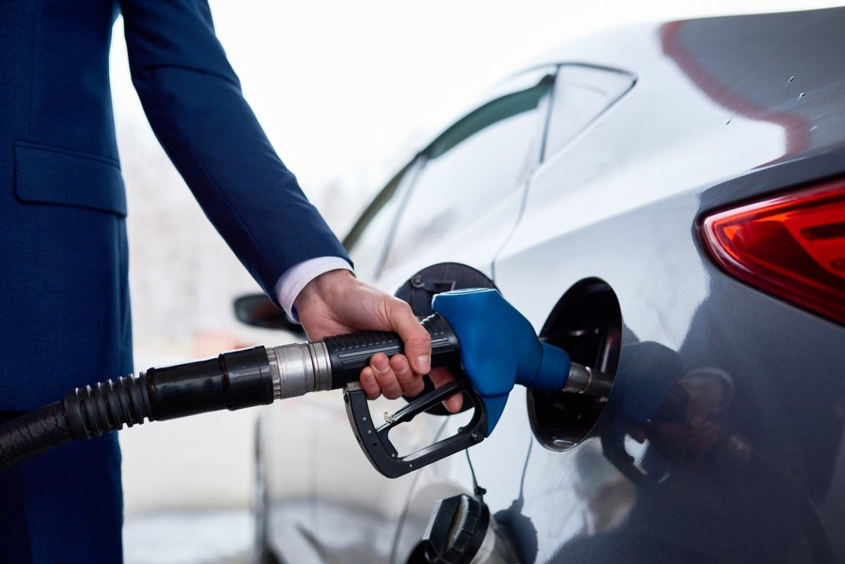 A businessman fills up his new car with E15 at a local gas station.