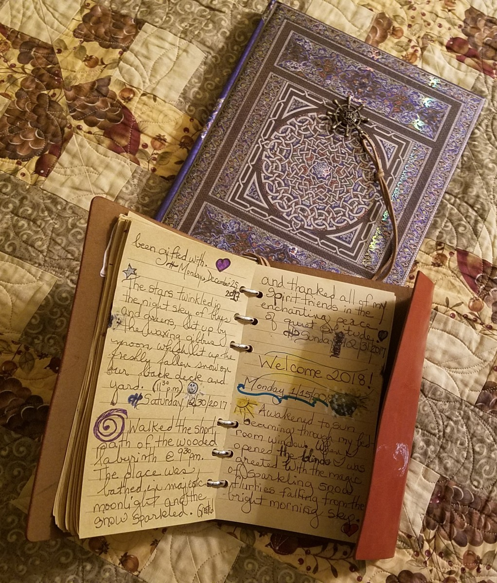 "I keep several journals for different types of reflection and expression.  The top one is my ""Journal of Enchanting Moments,"" which focuses on my encounters with nature.   Below it is my Dream jounral."