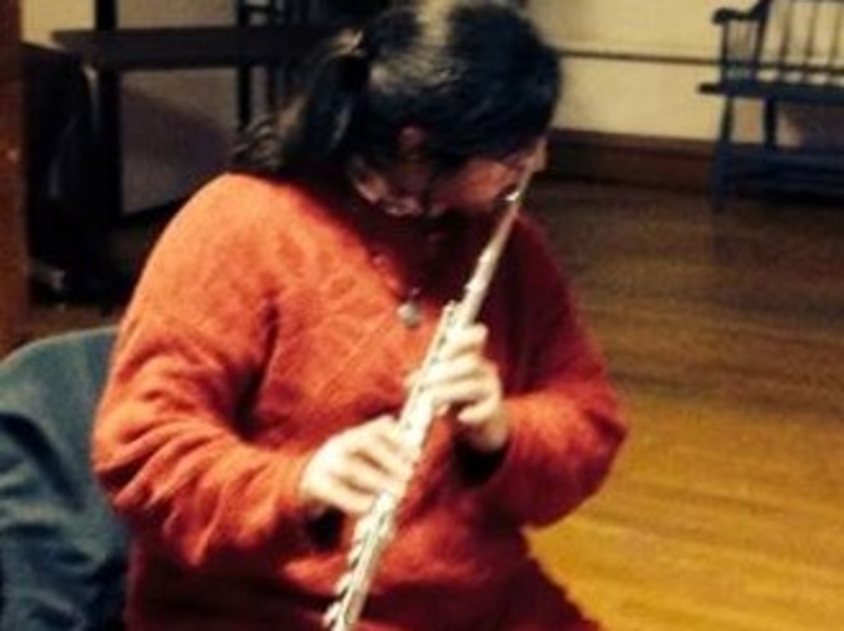 "Seafarer Mama played a jazzy version of ""Jingle Bells"" on her flute with a bunch of musician friends at her UU church's Second Friday Sessions."