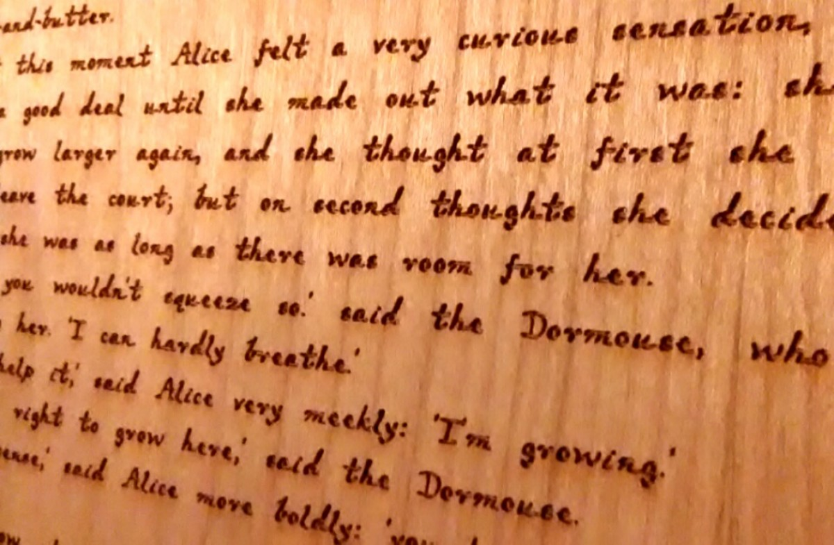 The engraved text on the wood pages was designed to resemble Lewis Carroll's handwriting.